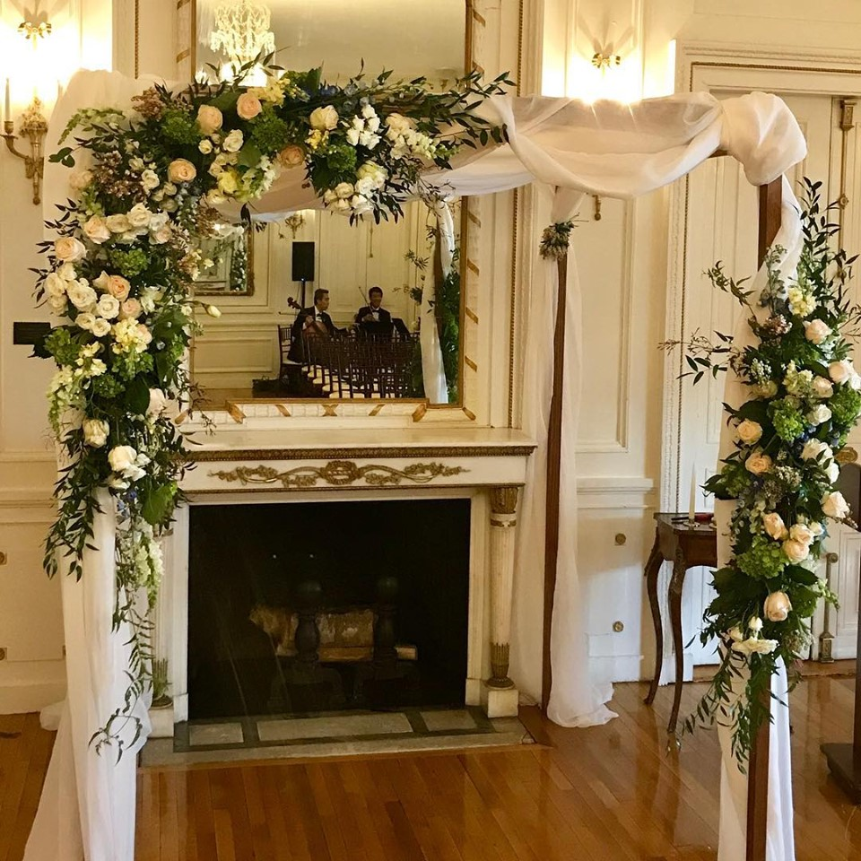 Photograph of floral wedding chuppah at Tupper Manor